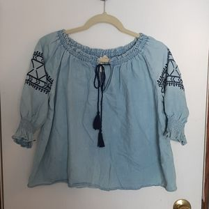Chambray, ruched and embroidered front tie blouse